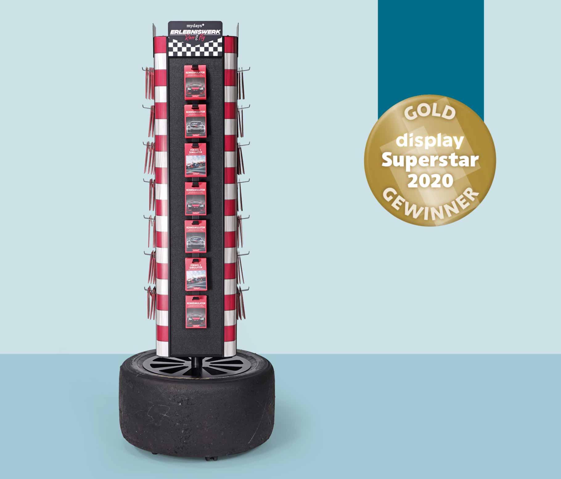 """2020: Geschenkkarten Display """"RACE"""" für die JOCHEN SCHWEIZER mydays Group wird der Superstar in Gold verliehen."""